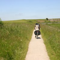 Cycling on the High Peak Trail, near Minninglow, Peak District, Derbyshire.