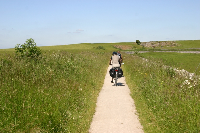 Cycling on the High Peak Trail, near Minninglow, Peak District, Derbyshire.