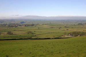 Looking southwest from Bretton Edge to Foolow, St Peter's Stone and the road to Litton