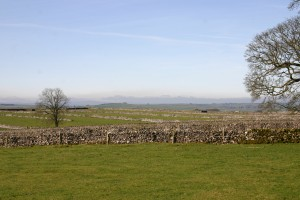 View across the fields and stone walls walking from Eyam to Foolow via Housley