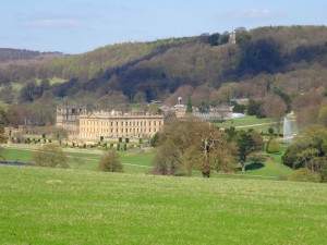 Chatsworth House with Stand Woods and the Hunting Tower  on the hill behind.