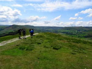 Hikers heading over Back Tor towards Mam Tor and Castleton